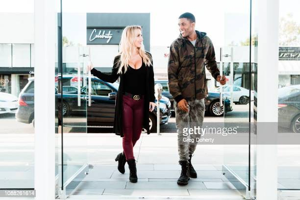 Amanda Paris and ELJAY visit Winn Slavin Fine Art wearing Timberland Boots at TAPGiveback Day on January 24 2019 in Los Angeles California