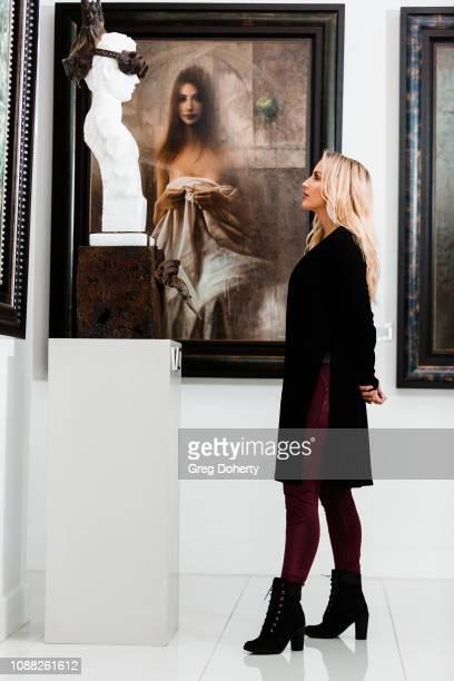 Amanda Paris visits Winn Slavin Fine Art wearing Timberland Boots at TAPGiveback Day on January 24 2019 in Los Angeles California