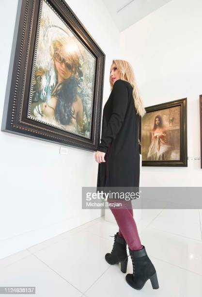 Amanda Paris visits Winn Slavin Fine Art wearing Timberland boots at TAP Giveback Day on January 24 2019 in Los Angeles California