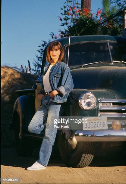 HILLS HOLLYWOOD CA DECEMBER 14 Amanda Pays English actress model stands next to her 1950's pick up outside the first home she purchased renovated and...