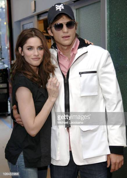 Amanda Peet and Ashton Kutcher during Ashton Kutcher and Amanda Peet Visit MTV's 'TRL' April 19 2005 at MTV Studios Times Square in New York City New...