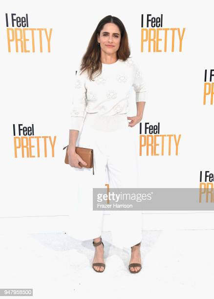 """Amanda Peet attends the premiere of STX Films' """"I Feel Pretty"""" at Westwood Village Theatre on April 17, 2018 in Westwood, California."""