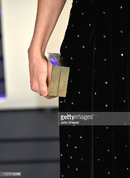 Amanda Peet purse detail attends the 2019 Vanity Fair Oscar Party hosted by Radhika Jones at Wallis Annenberg Center for the Performing Arts on...