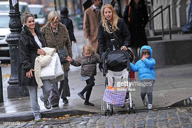 Amanda Peet with her mother Penny Peet and daughter Frances Pen Benioff on the streets of Manhattan on November 30 2010 in New York City