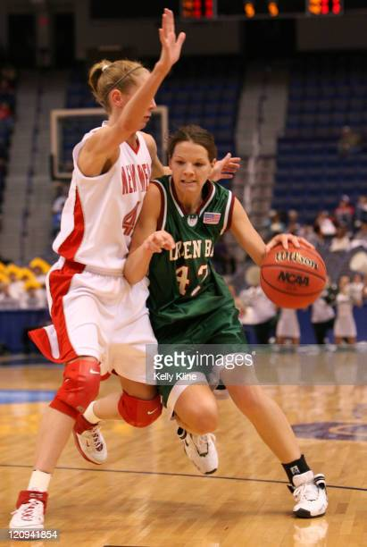 Amanda Popp of UW GreenBay drives to the basket on Julie Briody of New Mexico at the Hartford Civic Center in Hartford CT on March 18 2007