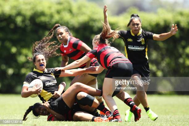Amanda Rasch of Wellington is brought down against Canterbury during the TECT National Sevens tournament at Tauranga Domain on December 16 2018 in...