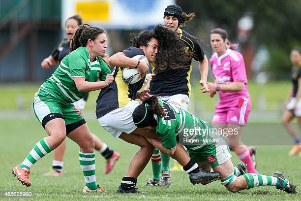 Amanda Rasch of Wellington is tackled by Christie Yule and Nicole Dickins of Manawatu during the round two Women's Provincial Championship match...