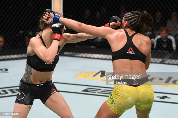 Amanda Ribas of Brazil and Emily Whitmire exchange punches in their women's strawweight bout during the UFC Fight Night event at the Target Center on...