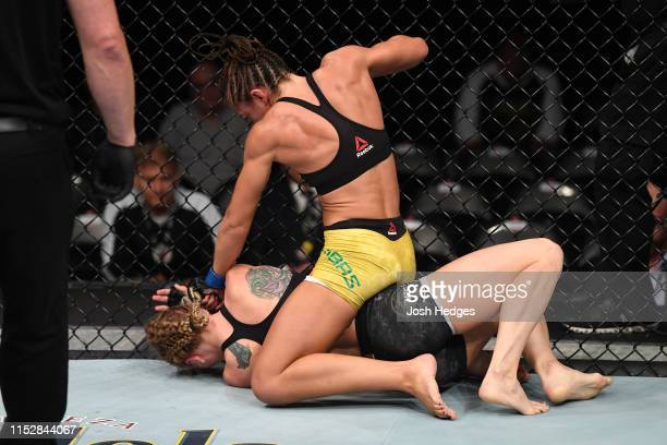 Amanda Ribas of Brazil punches Emily Whitmire in their women's strawweight bout during the UFC Fight Night event at the Target Center on June 29 2019...