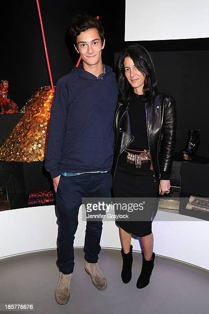 Amanda Ross and guest attend The Haas Brothers for Versace event at the Versace SoHo Boutique on October 24 2013 in New York City