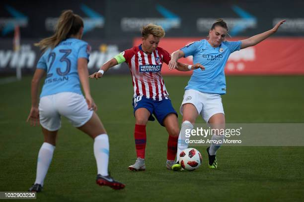 Amanda Sampedro of Atletico de Madrid competes for the ball with Melissa Lawley of Manchester City during the UEFA Women Champions League Round of 32...