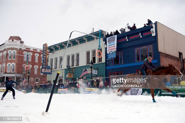 Amanda Sanders races down Harrison Avenue while pulling skier Chris Pitcher during the 71st annual Leadville Ski Joring weekend competition on March...