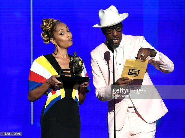 Amanda Seales and J B Smoove speak onstage during the 2019 NBA Awards presented by Kia on TNT at Barker Hangar on June 24 2019 in Santa Monica...