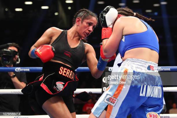 Amanda Serrano lands a left hand against Yamila Reynoso at Barclays Center on September 8 2018 in the Brooklyn borough of New York City Serrano would...