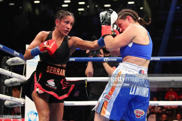Amanda Serrano lands a left hand against Yamila Reynoso at Barclays Center on September 8 2018 in New York City Serrano would win by unanimous...