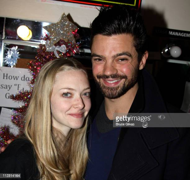 Amanda Seyfried and boyfriend Dominic Cooper pose backstage at the hit rock musical Rock of Ages on Broadway at The Brooks Atkinson Theater on...