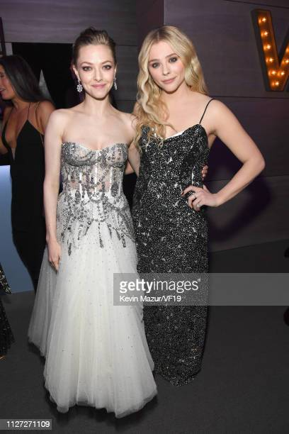 Amanda Seyfried and Chloë Grace Moretz attend the 2019 Vanity Fair Oscar Party hosted by Radhika Jones at Wallis Annenberg Center for the Performing...