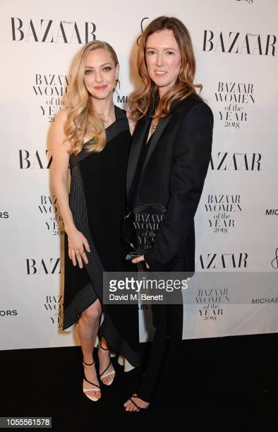 Amanda Seyfried and Clare Waight Keller attend the Harper's Bazaar Women Of The Year Awards 2018 in partnership with Michael Kors and MercedesBenz at...