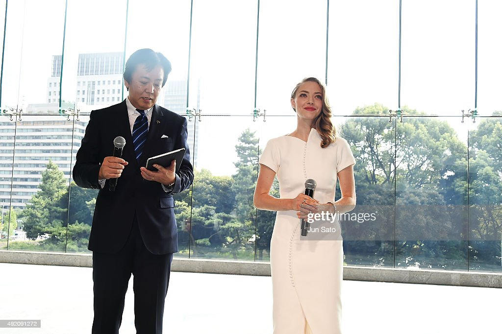 Amanda Seyfried and General Manager of Shiseido Co., Ltd. Keiichi Fujii attend the promotional event for Shiseido's Cle de Peau Beaute at the Palace Hotel on October 9, 2015 in Tokyo, Japan.