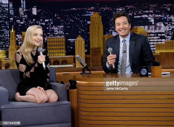 Amanda Seyfried and host Jimmy Fallon sing during the 'Google Translates Songs' segment on 'The Tonight Show Starring Jimmy Fallon' at Rockefeller...