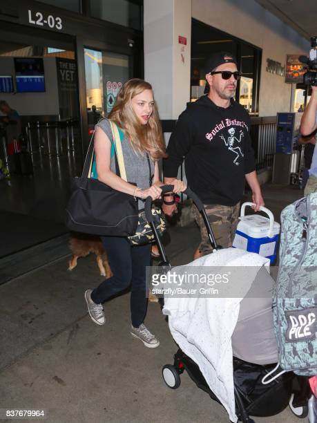 Amanda Seyfried and Thomas Sadoski are seen at Los Angeles International Airport on August 22 2017 in Los Angeles California