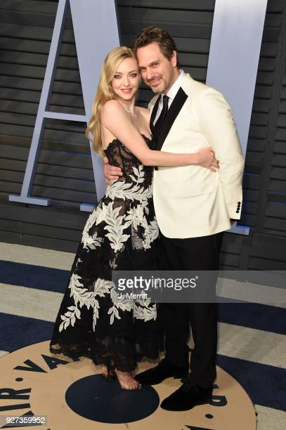 Amanda Seyfried and Thomas Sadoski attend the 2018 Vanity Fair Oscar Party hosted by Radhika Jones at the Wallis Annenberg Center for the Performing...
