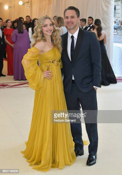Amanda Seyfried and Thomas Sadoski attend the Heavenly Bodies Fashion The Catholic Imagination Costume Institute Gala at The Metropolitan Museum of...