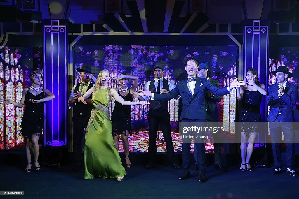 Amanda Seyfried dances with Kentaro Fujiwara, CEO of Shiseido China during the promotional event for Shiseido's Cle de Peau Beaute at Fairmont Peace Hotel on June 16, 2016 in Shanghai, China.