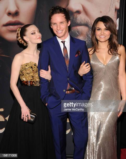Amanda Seyfried Eddie Redmayne and Samantha Barks attend the Les Miserables New York premiere at Ziegfeld Theater on December 10 2012 in New York City