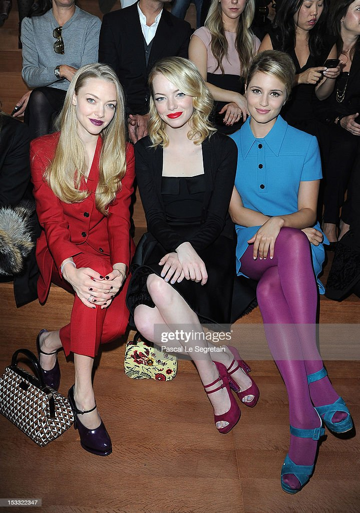 Amanda Seyfried, Emma Stone and Dianna Agron attend the Miu Miu Spring/Summer 2013 show as part of Paris Fashion Week on October 3, 2012 in Paris, France.