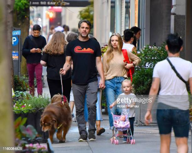 Amanda Seyfried husband Thomas Sadoski daughter Nina and their dog Finn seen out and about in Manhattan on August 6 2019 in New York City