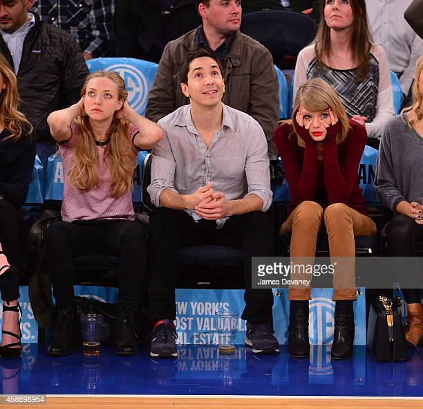 Amanda Seyfried Justin Long and Taylor Swift attend the Orlando Magic vs New York Knicks game at Madison Square Garden on November 12 2014 in New...