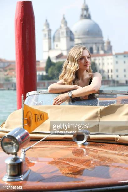 Amanda Seyfried poses on a water taxi for a portrait wearing a Jaeger-LeCoultre watch during the 76th Venice Film Festival outside of the Hotel Bauer...