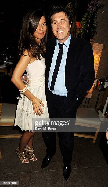 Amanda Sheperd and Bryan Ferry attends the launch party for the opening of TopShop's Knightsbridge store on May 19, 2010 in London, England.