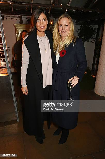 Amanda Sheppard and Astrid Harbord attend a candlelit dinner for VINCE at Clifton Nurseries on November 11 2015 in London England
