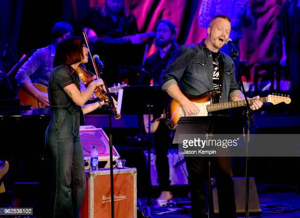Amanda Shires and Jason Isbell perform onstage for Country's Roaring '70s Outlaws and Armadillos exhibition opening concert at Country Music Hall of...