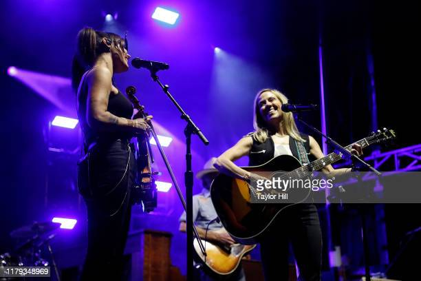 Amanda Shires and Sheryl Crow perform during the inaugural Shoals Fest at McFarland Park on October 05 2019 in Florence Alabama