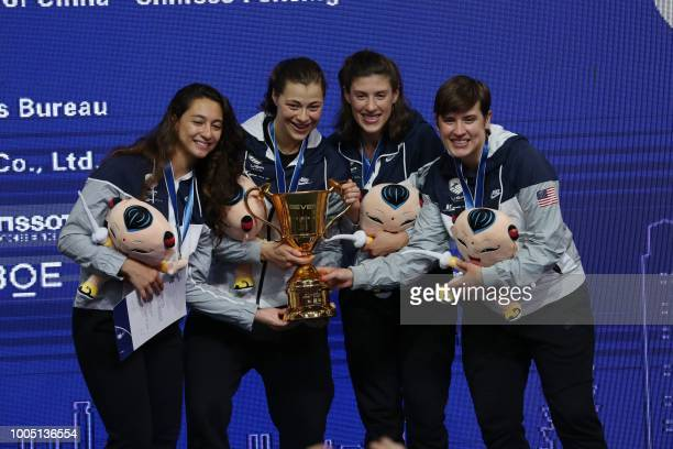 Amanda Sirico Katharine Holmes Kelley Hurley and Courtney Hurley from the United States fencing team pose for a photo during the award ceremony after...