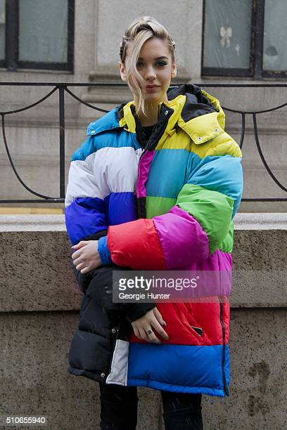 Amanda Steele seen at Skylight at Moynihan Station outside the Jeremy Scott show wearing multicolor puffer coat with braided hair during New York...