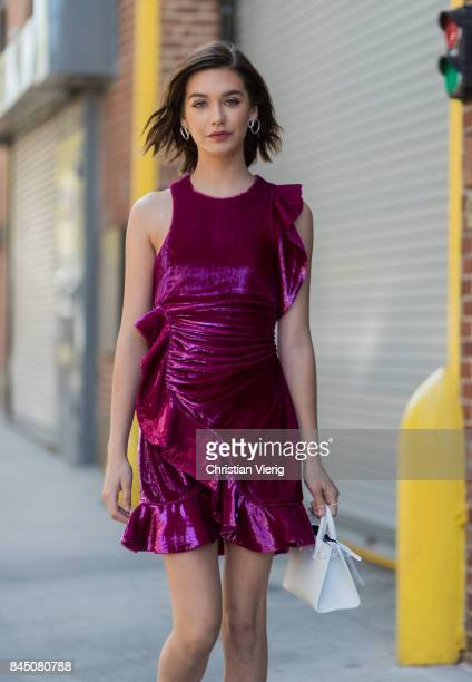 Amanda Steele wearing a purple dress seen in the streets of Manhattan outside SelfPortrait during New York Fashion Week on September 9 2017 in New...