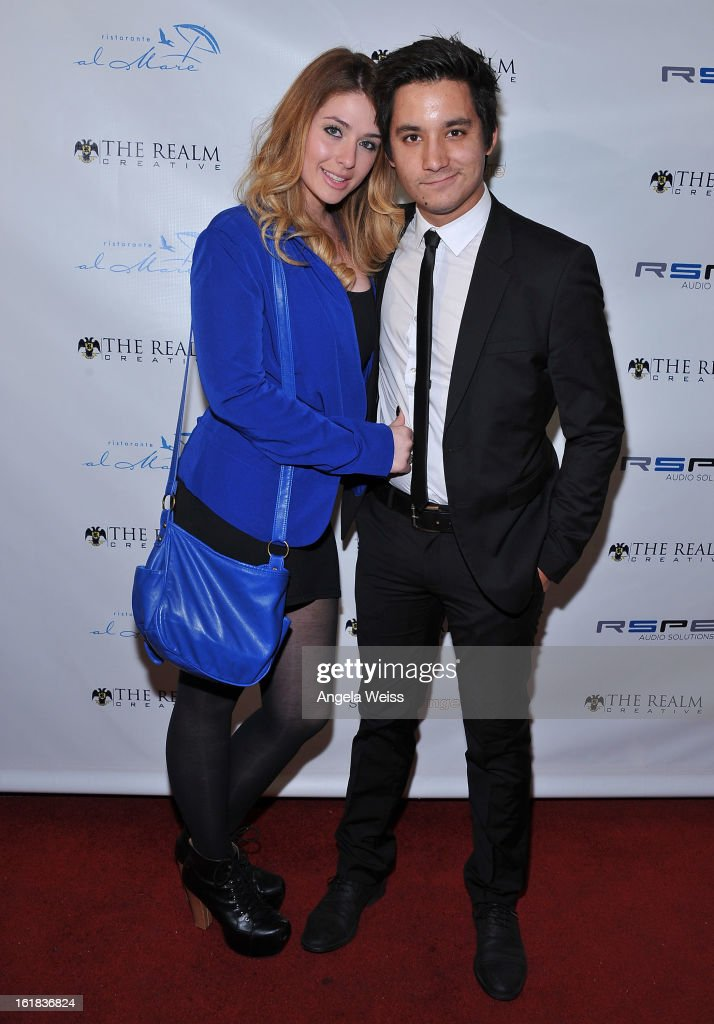 Amanda Stephens and Carl Himmelman attend The Realm Creative red carpet premier party on February 16, 2013 in Los Angeles, California.
