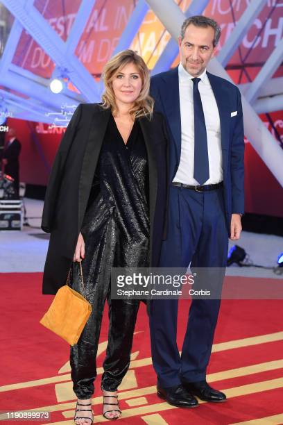 Amanda Sthers and a guest attend the opening ceremony during the 18th Marrakech International Film Festival on November 29 2019 in Marrakech Morocco