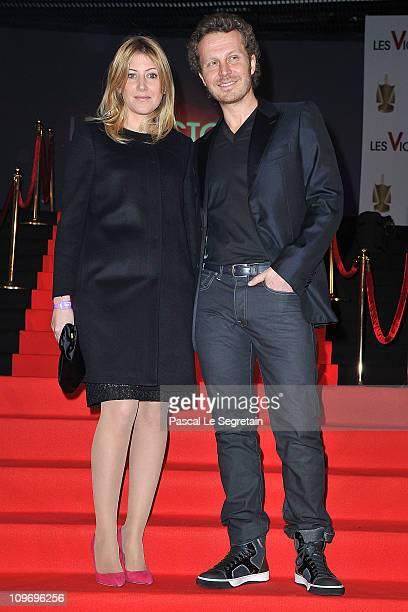 Amanda Sthers and Sinclair arrive for Les Victoires de La Musique 2011 at Palais des Congres on March 1 2011 in Paris France