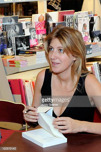 Amanda Sthers poses during her book signing for 'Les terres saintes' held at Galeries Lafayette on June 24 2010 in Paris France