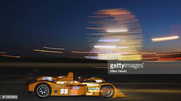 Amanda Stretton of Great Britain and Team Chamberlain Lola AER drives past the funfair during final qualifying for the 76th running of the Le Mans 24...