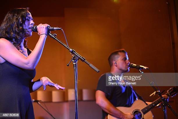 Amanda Sudano and Abner Ramirez of Johnnyswim perform at the Levitt Pavilion in Los Angeles California stage on July 30 2015