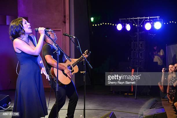 Amanda Sudano and Abner Ramirez of Johnnyswim perform at the Levitt Pavilion in Los Angeles California stage on July 30 2015