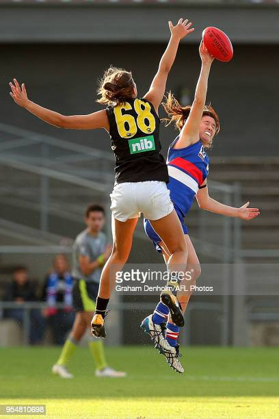 Amanda Tessari of the Western Bulldogs and Alice Edmonds of Richmond compete in the air during the round one AFLW match between the Western Bulldogs...