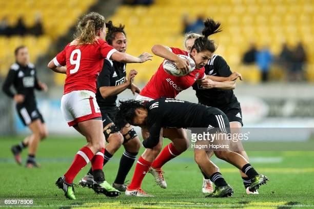 Amanda Thornborough of Canada is tackled by Renee Wickliffe of New Zealand during the Women's International Test match between the New Zealand Black...