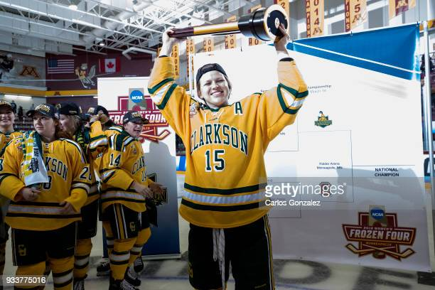Amanda Titus of Clarkson University celebrated with the championship Trophy after winning the Division I Women's Ice Hockey Championship held at...